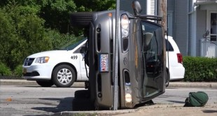 Driver flips car onto its side on Acushnet Ave in New Bedford MA
