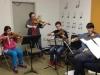 Teacher Brianne with strings ensemble