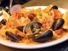 black whale seafood paella mussels shrimp littlenecks squid in spicy saffron rice with chorizo and peas.jpg