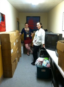 Students Victoria Duverge  and Delana Baldwin making a delivery.